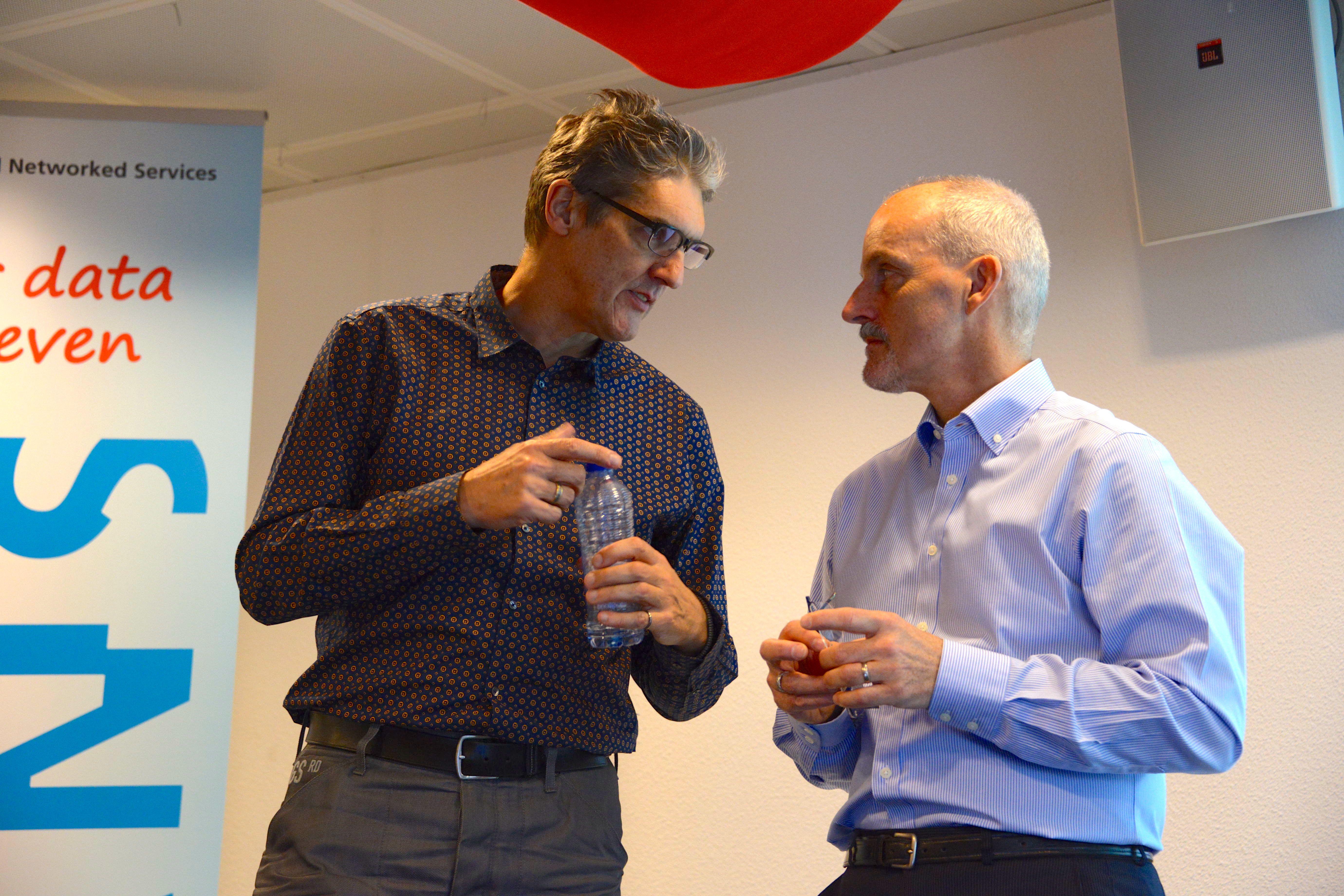 Two 'great thinkers and doers' confer - Herbert van de Sompel (left) and Andrew Treloar